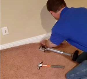 stretching wrinkled carpet